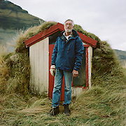Guðmundur Pálsson, 75 y.o, farmer. We met on October 13th 2013 as I was walking around a mountain resembling a shark fin, just outside Grundarfjörður. A hostel staff from the youth hostel had told me it would take about two hours to go around the mountain but in fact it turned out to be at least four. At first you have to walk along the coast, then a little bit uphill, then again along the coast. Why on earth did I need to go there? The thing is, on the other side of the mountain that is sheltered from the wind there are sometimes seals on the shore. They lie around there because it is very solitary and no one ever goes there. The seals are closely followed by killer whales, who hunt them. Both the species are particularly abundant in that area in February: you don't even need to go behind the mountain: you can stand right in the centre of the town, on the embankment, and watch the water teem with fins. But in October, helas, the water in the bay is too warm for the seals to come closer to the shore, so I didn't see any seals nor killer whales. But, coming back from behind the mountain, I met Guðmundur! His farm is the only inhabited place in the area. But long before I saw it, I smelt it. It was a pleasant smoke scent and something else. It turned out to be sausages smoking in a turf hut (in the pic). I asked  to have a look inside: in the darkness of the turf house sausages were hanging from the ceiling, and in the foreground dried sheep dung was burning on an open fireplace. Then we went into his house where I detected tomatoes growing on the window sill. It was a big joy because finally we had something to talk about: by gestures (Guðmundur didn't speak any English) I explained that I also grow tomatoes on a window sill in my home in Moscow. He appeared really glad about it and proudly indicated a single light green tomato. 'Here's a polar Vavilov!', I thought with delight. It was towards 5 p.m., there was a strong north-west wind. We had some