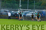 Na Gaeil's keeper Devon Burns rises highest to clear a Currow effort as Kieran Dineen and Andrew Barry keep a check on Currows Sean McCarthy in the Intermediate Club Championship