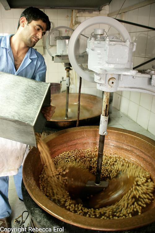 Adding hazelnuts during the making of Turkish delight, Turkey