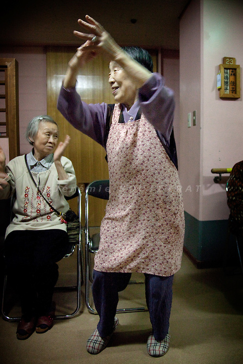 Tokyo - 3rd of December 2009 - Kotohen nursery and nursing home in the Edogawa district. Tsukaguchi Tsuroko , 80, dancing with the kids during their visit.
