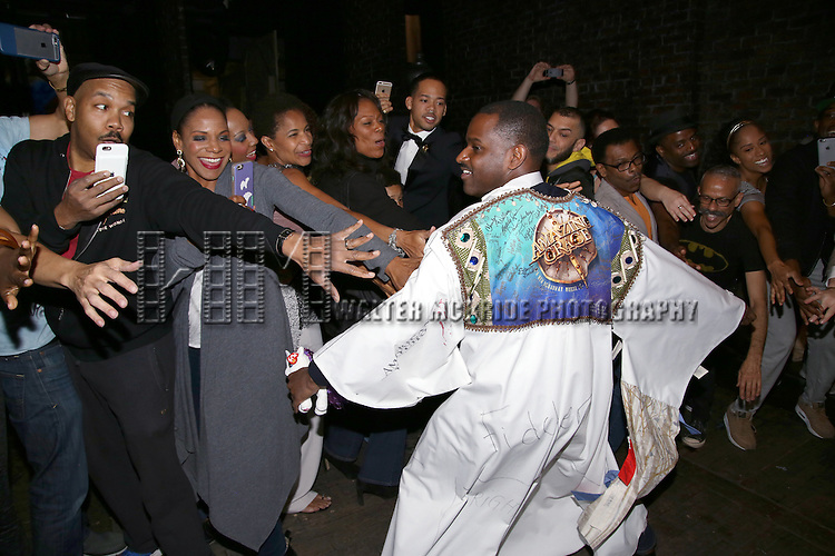 Audra McDonald and Arbender Robinson with cast during the Actors' Equity Opening Night Gypsy Robe Ceremony honoring Arbender Robinson for 'Shuffle Along' at The Music Box Theatre on April 28, 2016 in New York City.