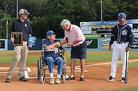 Asheville Tourists owner Brian DeWine presents plaques to former Tourists manager Ray Hathaway during Ray Hathaway night along with former major league manager Dave Bristol and current Tourists manager Joe Mikulik before a game against the Rome Braves at McCormick Field on August 20, 2011 in Asheville, North Carolina. Rome won the game 10-9.   (Tony Farlow/Four Seam Images)