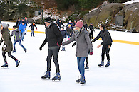 A couple skating on Wollman Rink right before he pops the question.