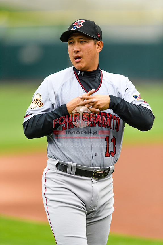 Jae-Gyun Hwang (13) of the Sacramento River Cats in the outfield before the game against the Salt Lake Bees in Pacific Coast League action at Smith's Ballpark on April 11, 2017 in Salt Lake City, Utah. The River Cats defeated the Bees 8-7. (Stephen Smith/Four Seam Images)