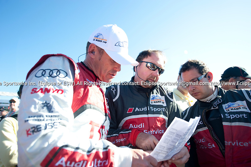 Audi driver Tom Kristensen (DNK) of the #2 car speaks with engineers on the gird before the 14th annual Petit Le Mans on Saturday October 1, 2011.