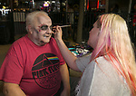Rick is getting his face painted by Lynzie during the Zombie Crawl held on Saturday night, October 26, 2019 in downtown Reno.