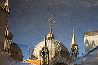 The Roof of Saint Mark's Basilica in a puddle reflection outside, Venice, Italy