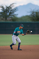 AZL Mariners shortstop Cesar Izturis Jr (3) fields a ball during an Arizona League game against the AZL White Sox at Camelback Ranch on July 8, 2018 in Glendale, Arizona. The AZL White Sox defeated the AZL Mariners 8-5. (Zachary Lucy/Four Seam Images)