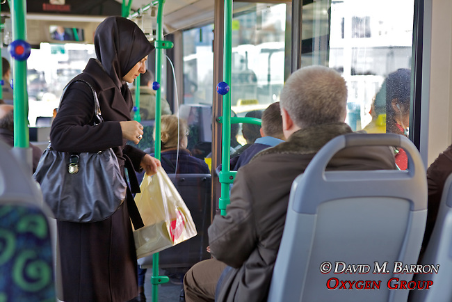 Woman On Bus Wearing Headscarf