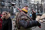 A Maidan square revolutionist walking in the streets of Kiev, Ukraine with his sledge-hammer on his shoulder.<br /> Rvoluzionario di Piazza Maidan si aggira per le strade con il martello in mano, Kiev, Ukraina.