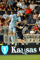 Aurelien Collin (78) KC Sporting defender wins the header against Eric Hassli Vancouver Whitecaps... Sporting KC defeated Vancouver Whitecaps 2-1 at LIVESTRONG Sporting Park, Kansas City, Kanas.