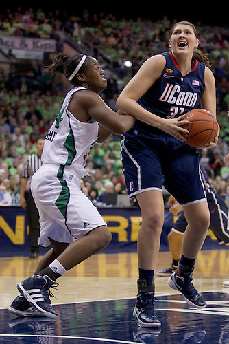 Connecticut center Stefanie Dolson (#31) drives to the basket as Notre Dame forward Markisha Wright (#34) defends in first half action of NCAA Women's basketball game between Connecticut and Notre Dame.  The Notre Dame Fighting Irish defeated the Connecticut Huskies 74-67 in overtime in game at Purcell Pavilion at the Joyce Center in South Bend, Indiana.