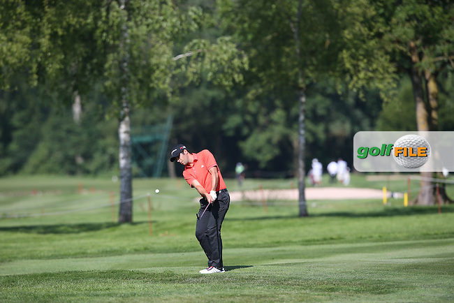 Adrian Otaegui (ESP) plays a low running chip onto the 7th during Round One of the 2015 BMW International Open at Golfclub Munchen Eichenried, Eichenried, Munich, Germany. 25/06/2015. Picture David Lloyd | www.golffile.ie