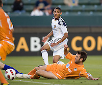Puerto Islanders Joshua Hansen (20) slides past LA Galaxy defender Sean Franklin (28). The Puerto Rico Islanders defeated the LA Galaxy 4-1 during CONCACAF Champions League group play at Home Depot Center stadium in Carson, California on Tuesday July 27, 2010.