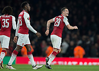 GranitXhaka of Arsenal celebrates scoring his sides second goal during the UEFA Europa League round of 16 2nd leg match between Arsenal and AC Milan at the Emirates Stadium, London, England on 15 March 2018. Photo by Vince  Mignott / PRiME Media Images.