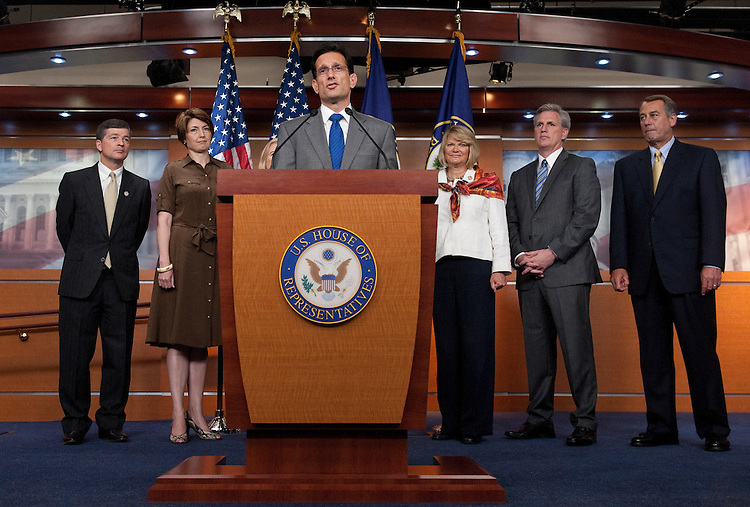 UNITED STATES - JULY 22: House Majority Leader Eric Cantor, R-Va., speaks to the media following the House Republican Conference meeting on Friday morning, July 22, 2011. In the background are Reps. Jeb Hensarling, Cathy McMorris Rogers, Candice Miller, Cynthia Lummis, Kevin McCarthy and Speaker John Boehner. (Photo By Bill Clark/Roll Call)