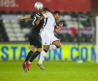 2nd January 2020; Liberty Stadium, Swansea, Glamorgan, Wales; English Football League Championship, Swansea City versus Charlton Athletic; Adam Matthews of Charlton Athleic and Wayne Routledge of Swansea City challenge for the ball   - Strictly Editorial Use Only. No use with unauthorized audio, video, data, fixture lists, club/league logos or 'live' services. Online in-match use limited to 120 images, no video emulation. No use in betting, games or single club/league/player publications