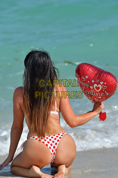 MIAMI BEACH, FL - FEBRUARY 14: (EXCLUSIVE COVERAGE) Star of French Reality show Secret story 9 and winner of the brunette girl of the year 2016 for Playboy Italy. Claudia Romani seen here wearing a red and white bikini on Valentine's Day. Claudia Romani is a model. She has appeared on covers such as GQ and Maxim, and in 2006 was voted one of the 100 Sexiest Women in the World by FHM Denmark on February 14, 2018 in Miami Beach, Florida. <br /> CAP/MPI122<br /> &copy;MPI122/Capital Pictures