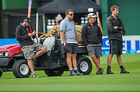 Basin Reserve ground staff come out to attend to the wicket at lunch during day one of the 2nd cricket test match between the New Zealand Black Caps and Sri Lanka at the Hawkins Basin Reserve, Wellington, New Zealand on Saturday, 3 February 2015. Photo: Dave Lintott / lintottphoto.co.nz