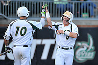 Second baseman Brett Netzer (9) of the Charlotte 49ers celebrates scoring a run in the third inning of Game 2 of a doubleheader against the Fairfield Stags on Saturday, March 12, 2016, at Hayes Stadium in Charlotte, North Carolina. (Tom Priddy/Four Seam Images)