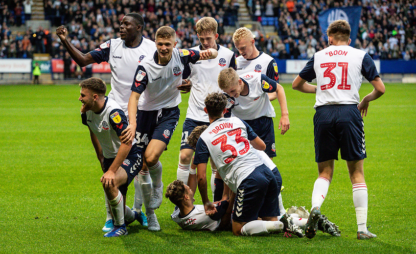 Bolton Wanderers' players celebrate scoring their side's first goal <br /> <br /> Photographer Andrew Kearns/CameraSport<br /> <br /> EFL Leasing.com Trophy - Northern Section - Group F - Bolton Wanderers v Bradford City -  Tuesday 3rd September 2019 - University of Bolton Stadium - Bolton<br />  <br /> World Copyright © 2018 CameraSport. All rights reserved. 43 Linden Ave. Countesthorpe. Leicester. England. LE8 5PG - Tel: +44 (0) 116 277 4147 - admin@camerasport.com - www.camerasport.com