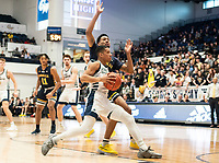 WASHINGTON, DC - FEBRUARY 22: Armel Potter #2 of George Washington moves past Scott Spencer #2 of La Salle during a game between La Salle and George Washington at Charles E Smith Center on February 22, 2020 in Washington, DC.
