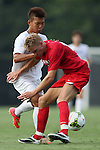 19 August 2014: Duke's Seo-In Kim (left) runs into Radford's Sergio Arzubiaga (right). The Duke University Blue Devils hosted the Radford University Highlanders at Koskinen Stadium in Durham, NC in a 2014 NCAA Division I Men's Soccer preseason match.