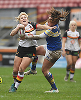 Picture by Anna Gowthorpe/SWpix.com - 15/04/2018 - Rugby League - Womens Super League - Bradford Bulls v Leeds Rhinos - Coral Windows Stadium, Bradford, England - Bradford Bulls' Amy Hardcastle is tackled by Leeds Rhinos' Caitlin Beevers