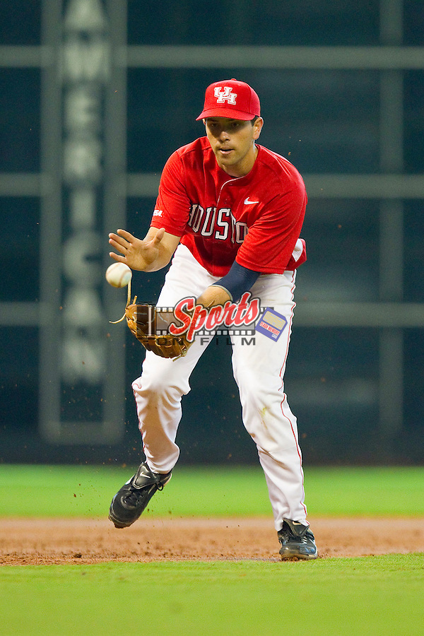 Third baseman Travis Trial #27 of the Houston Cougars charges a ground ball against the Kentucky Wildcats at Minute Maid Park on March 5, 2011 in Houston, Texas.  Photo by Brian Westerholt / Four Seam Images