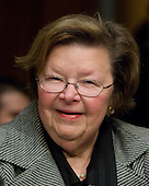 Washington, D.C. - January 8, 2009 -- United States Senator Barbara Mikulski (Democrat of Maryland) smiles as she awaits the arrival of former United States Senator Tom Daschle (Democrat of South Dakota) to testify before the United States Senate Committee on Health, Labor, Education, and Pensions on his nomination to be Secretary of Health and Human Services in Washington, D.C. on Thursday, January 8, 2009..Credit: Ron Sachs / CNP