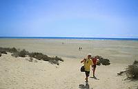 Walking across the beach,Corralejo,Fuerteventura, Canary Islands.