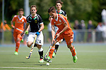 GER - Mannheim, Germany, May 16: During the whitsun tournament boys hockey match between Germany (black) and The Netherlands (orange) on May 16, 2016 at Mannheimer HC in Mannheim, Germany. Final score 4-3 (HT 2-0). (Photo by Dirk Markgraf / www.265-images.com) *** Local caption *** Bodie Berenos #19 of The Netherlands, Tim Bamberg #4 of Germany (U16)