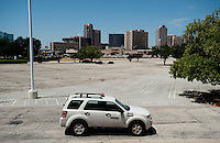A security car passes through an empty parking lot at the Valley View Center Mall in Dallas, Texas, Saturday, August 21, 2010. ..MATT NAGER for the Wall Street Journal