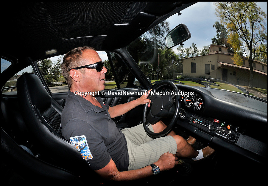 BNPS.co.uk (01202 558833)<br /> Pic: DavidNewhardt/MecumAuctions/BNPS<br /> <br /> Steve McQueen's son Chad trys out the Porsche.<br /> <br /> The Great Escaper....Steve McQueen's Porsche Turbo - customised to help him outrun the cops...and the press.<br /> <br /> The last car bought by Hollywood badboy Steve McQueen before his untimely death 35 years ago which he customised to help him outrun paparazzi photographers has been put up for sale.<br /> <br /> McQueen, a renowned petrolhead, had the Porsche 930 Turbo Carrera custom made in 1976, four years before he died from cancer aged 50.<br /> <br /> He was one of the hottest stars on the planet at the time, and at his request the turbo-charged sports car was fitted with a list of added extras including a special switch that turned off the rear lights to make it hard to spot at night.<br /> <br /> The car is being sold by collector and restorer Mike Regalia at Mecum Auctions in Monterey, California.<br /> <br /> Experts there are remaining tight-lipped about how much they expect it to fetch - but it is likely to be hundreds of thousands of pounds