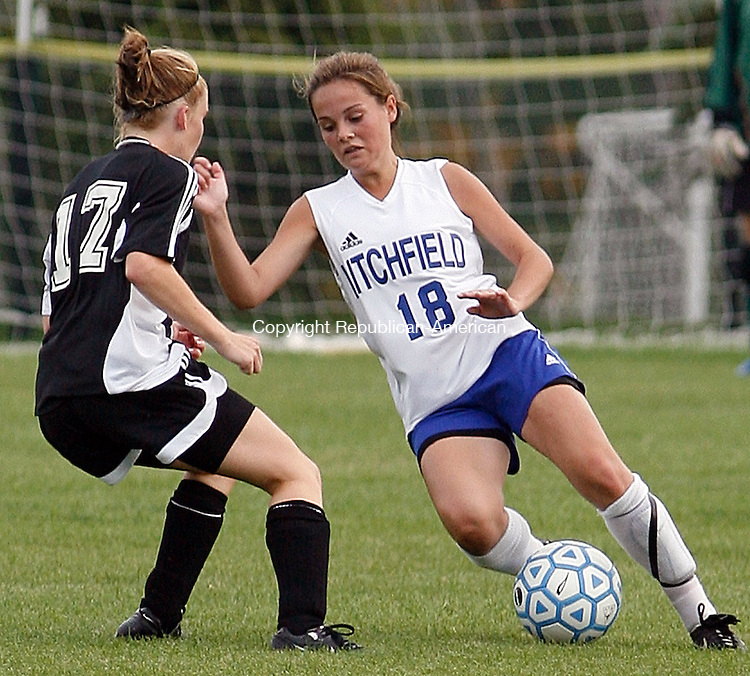 Litchfield's #18 Jordan Quesnel moves the ball past  Terryville's #17 Shannon Skidmore during Berkshire League girls soccer action  at Litchfield High School Thursday afternoon  Terryville defeated Litchfield two - nil.  Michael Kabelka / Republican-American