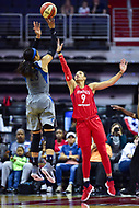 Washington, DC - May 27, 2018: Minnesota Lynx forward Maya Moore (23) shoots a jump shot over Washington Mystics guard Natasha Cloud (9) during game between the Mystics and Lynx at the Capital One Arena in Washington, DC. (Photo by Phil Peters/Media Images International)