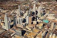 Aerial photography of downtown / uptown / center city Charlotte, NC, by photographer Patrick Schneider. Photos taken in November 2009 to show the Charlotte skyline with one of its newest skyscrapers that have appeared in the southern city's skyline, including the Duke Energy Center, a 764-foot tall, 49-floor skyscraper (54 floors total with mechanical floors) completed in 2009. Charlotte is the largest city in North Carolina and the seat of Mecklenburg County. An estimated 687,500 people live in Charlotte, making it one of the 20 largest cities in the country.