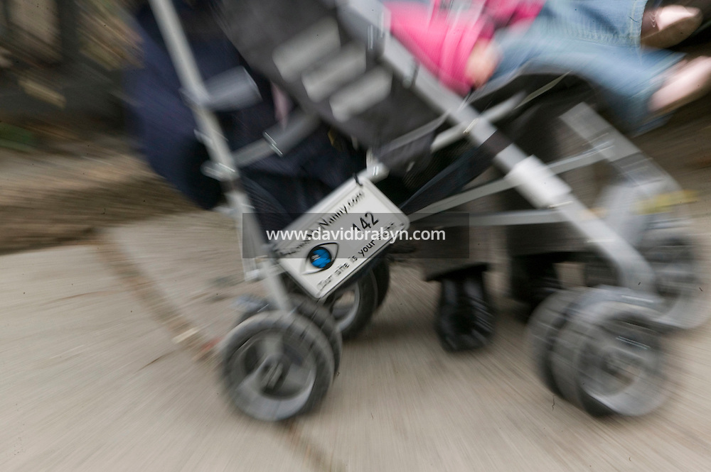 22 November 2006 - New York City, NY - Zoomed image of a stroller carrying a Howsmynanny.com number plate in a park in New York City, USA, 22 November 2006. The plate allows people to report any good or bad behaviour by the nanny to the website which then relays it to the parents.