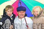 Jake, Mike and Sam Caherciveen shield from the rain at the Caherciveen races on Sunday   Copyright Kerry's Eye 2008