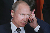 President Vladimir Putin of Russia takes a call during a luncheon hosted by United Nations Secretary-General Ban Ki-moon at the 70th annual UN General Assembly at the UN headquarters September 28, 2015 in New York City. U.S. President Barack Obama will hold a bilateral meeting with Putin later in the day. <br /> Credit: Chip Somodevilla / Pool via CNP