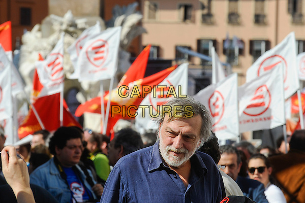 GINO STRADA, founder of Emergency.Demonstration against war for peace in Libya, organized by the NGO 'Emergency' in Piazza Navona, Romwe, Italy..April 2nd, 2011.headshot portrait beard facial hair flags people .CAP/EPS/GG.©Giuseppe Giglia/EPS/Capital Pictures