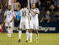 LA Galaxy forward's Tristan Bowen (17) and Landon Donovan (10) congratulate each after a goal. The LA Galaxy and the San Jose Earthquakes played to a 2-2 draw at Home Depot Center stadium in Carson, California on Thursday July 22, 2010.