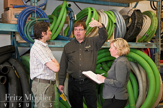 Chris May of Yukon Pump shows supplies to customers