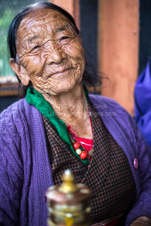 Thimphu, Bhutan.  Old Woman Worshiping at the National Memorial Chorten.