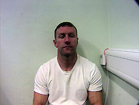 "Pictured: Police custody picture of Nathan James Parry<br /> Re: Three men have been jailed for posing as police in a car with blue flashing lights and kidnapping a businessman.<br /> Car valet Nathan Parry, 37, of Ellesmere Port, was described as the ""brains"" behind the offence and jailed for 12 years at Caernarfon Crown Court.<br /> Andrew Ballantyne, 36, and David Staff, 34, both from Chester, were ""willing lieutenants"" and each locked up for seven years.<br /> The 33-year-old victim was handcuffed in a stolen Audi in a four-hour ordeal."