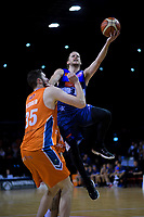 Damon Heuir (Giants) lays a shot up under pressure from Alex Pledger (Sharks) during the national basketball league semifinal match between Nelson Giants and Southland Sharks at TSB Bank Arena in Wellington, New Zealand on Saturday, 4 August 2018. Photo: Dave Lintott / lintottphoto.co.nz