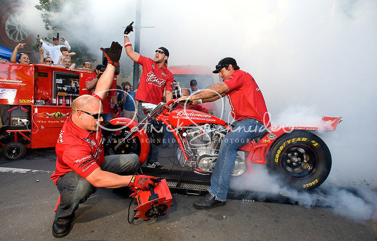 A team demonstrates a burn out on the Budweiser chopper Food Lion Speed Street in uptown Charlotte, NC.