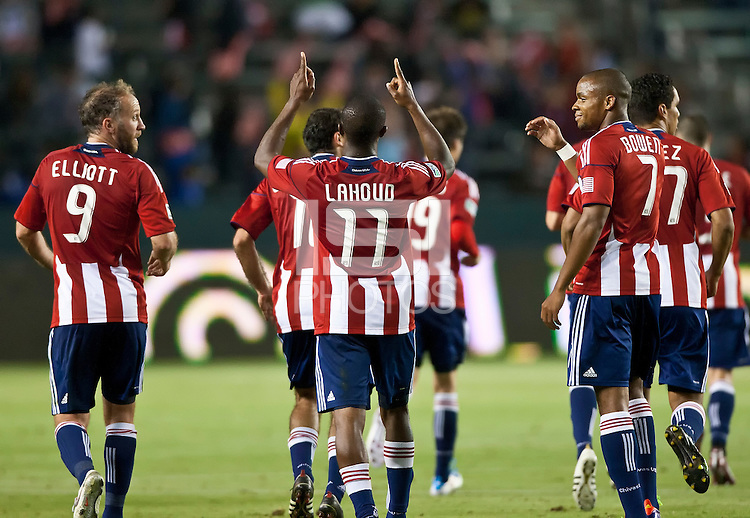 CARSON, CA – June 18, 2011: Chivas USA defender Michael Lahoud (11) celebrates his goal during the match between Chivas USA and FC Dallas at the Home Depot Center in Carson, California. Final score Chivas USA 1, FC Dallas 2.