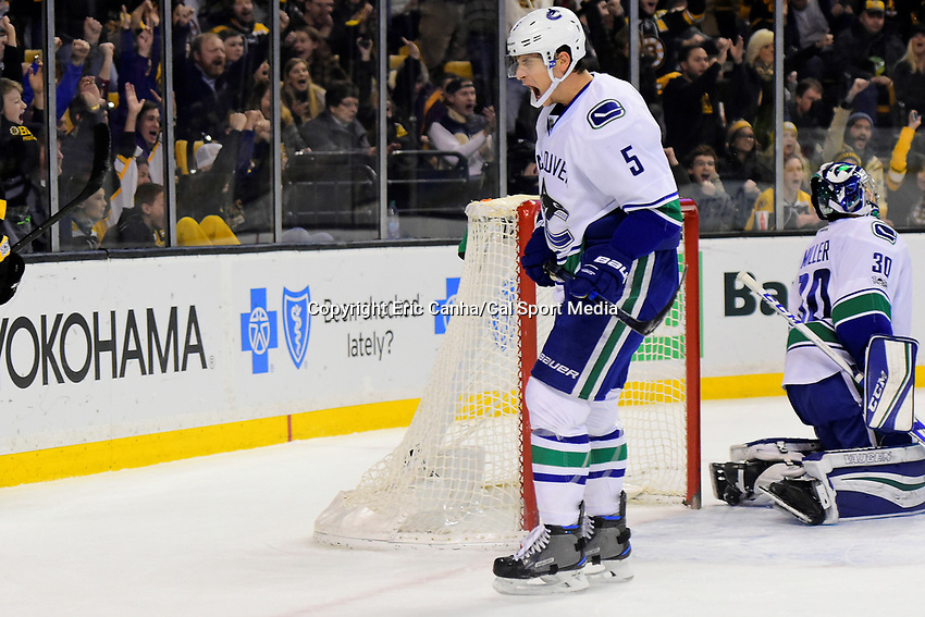 February 11, 2017: Vancouver Canucks defenseman Luca Sbisa (5) reacts to a goal against goalie Ryan Miller (30) during the National Hockey League game between the Vancouver Canucks and the Boston Bruins held at TD Garden, in Boston, Mass. Boston defeats Vancouver 4-3 in regulation time. Eric Canha/CSM