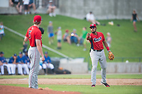 Orem Owlz third baseman Kevin Maitan (9) tosses the ball to starting pitcher John Swanda (5) during a Pioneer League game against the Missoula Osprey at Ogren Park Allegiance Field on August 19, 2018 in Missoula, Montana. The Missoula Osprey defeated the Orem Owlz by a score of 8-0. (Zachary Lucy/Four Seam Images)